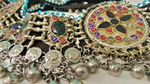 Elaborate belt for the hips, with precious stones, coins and beads