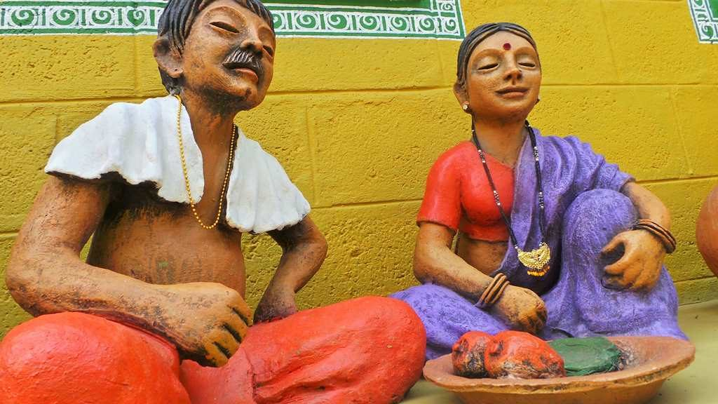 A couple depicting rural life-by Terracotta artist Venki Palimar
