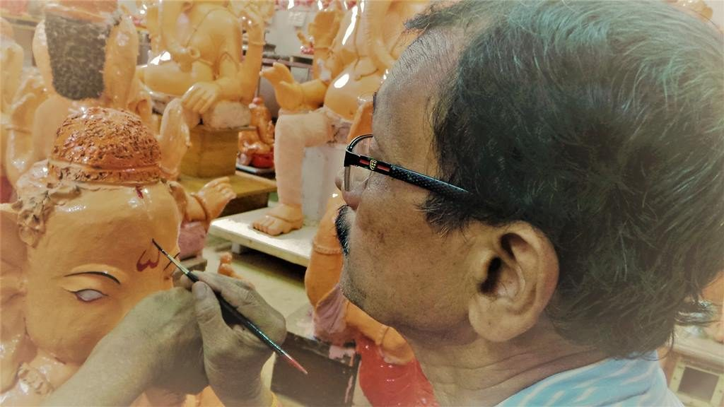 Painting in progress. Ganapathi idols in clay