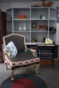 A winged chair and side table from Pondi