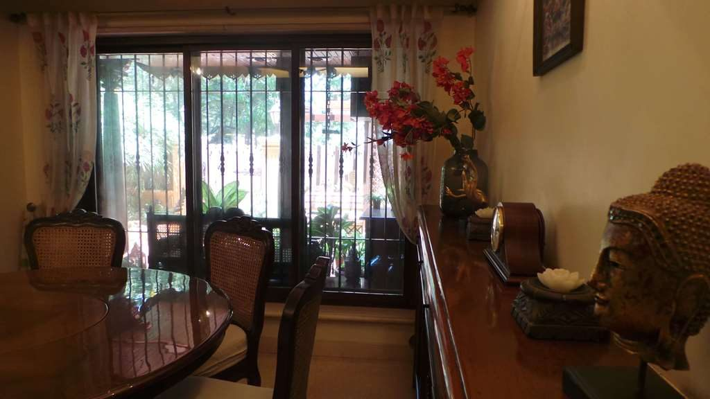 Koppikers Mumbai Home Dining overlooking the garden Oasis of calm Block printed curtains